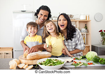 Lively family having fun in the kitchen - Lively family...