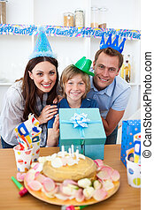 Lively parents celebrating their son\'s birthday