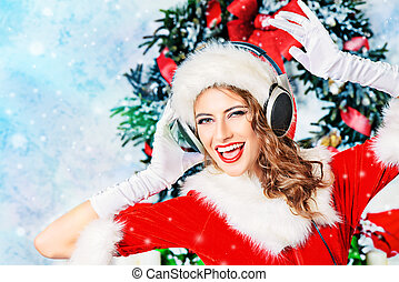 lively party - Beautiful young woman in Santa Claus costume...