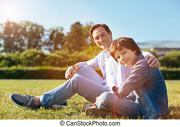 Lively positive child spending the day with his parent