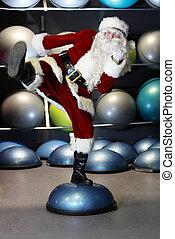 Santa Claus exercising with half-ball