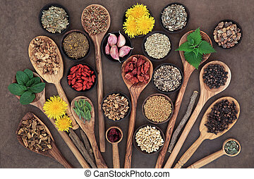 Liver detox super food selection in wooden bowls and spoons over brown paper background..