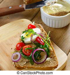 Liver paste sandwich with vegetables arugula and boiled egg...