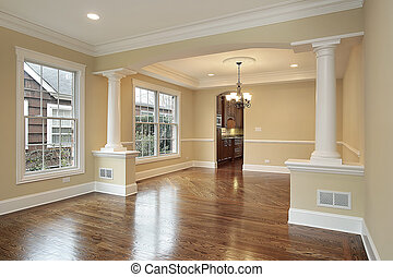 Living and dining room with white pillars