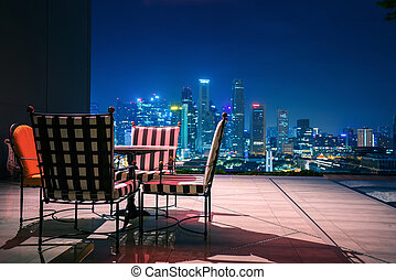 Living room and relax corner on roof top of hotel in Singapore