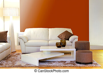 Modern white leather sofa with interesting coffee table