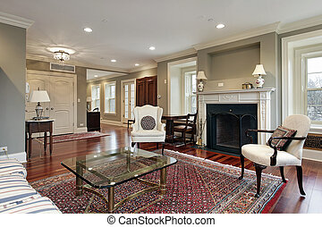 Living room in luxury home with view into foyer
