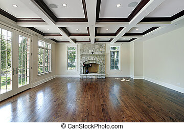 Living room in new construction home with wood ceiling...