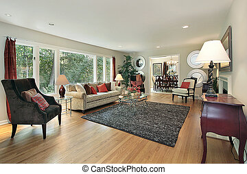 Living room in remodeled home with dining room view