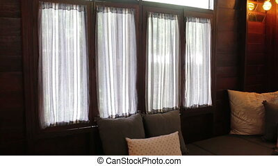 Living room interior window with handmade curtains, stock...