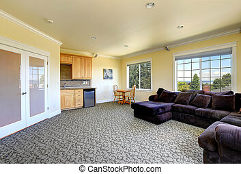 Living room interior with kitchen and dining area