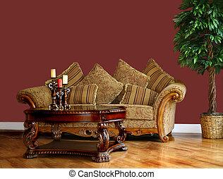 Living room with minimal furnishings; blank wall