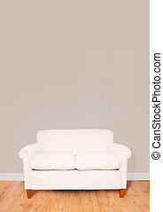 Living room - Modern cream sofa against a blank wall with...