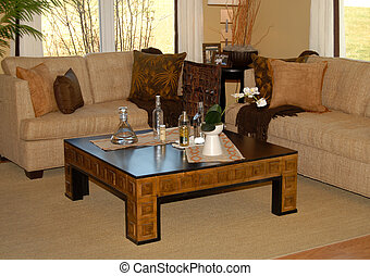 Living room setting with couch and coffee table done in...