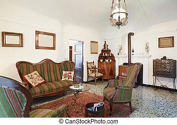 Living room with antiquities, italian interior