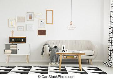 Living room with beige settee - Blanket on beige settee and...