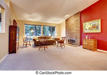 Living room with brick fireplace and carpet.