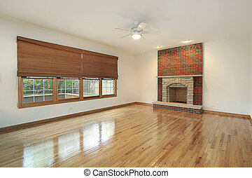 Living room with brick fireplace