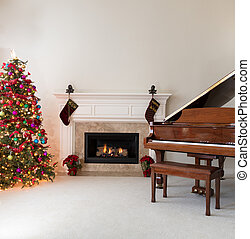 Living room with burning fireplace decorated for Christmas season