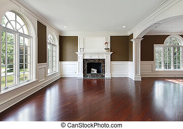 Living room with cherry wood flooring - Living room in new...