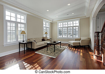 Living room with cherry wood flooring - Living room in...