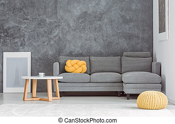 Living room with contrast walls - Yellow pouf in front of...