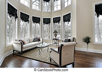 Living room in new construction home with curved windoes