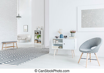 Living room with gray armchair
