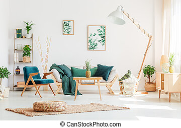 Living room with green furniture - Pineapple on wood stool ...