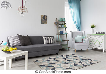 Living room with grey sofa coffee table