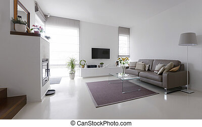 living room with leather sofa and glass table - White living...