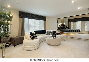 Living room with mirrored walls - Living room in luxury home...