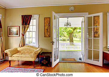 Living room with open doors to the front porch. Romantic...