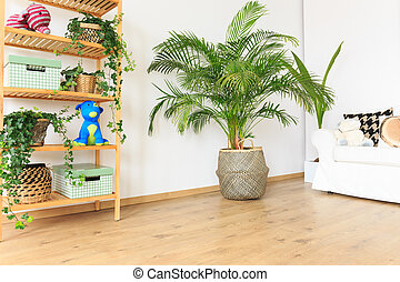 Living room with plants - Spacious wooden living room with ...