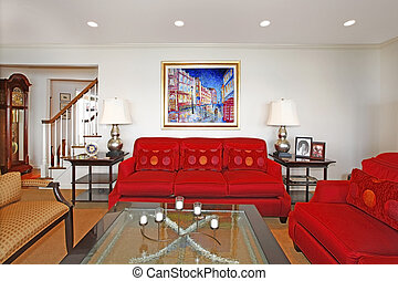Living room with red sofas