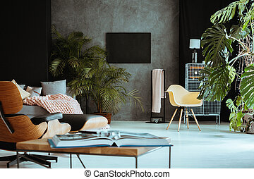 Living room with retro furniture and plants