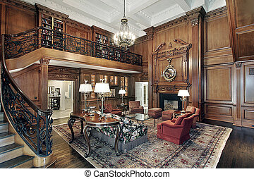 Living room in mansion with second story balcony