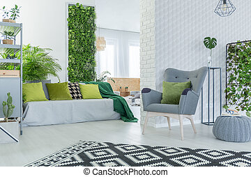 Living room with sofa and armchair