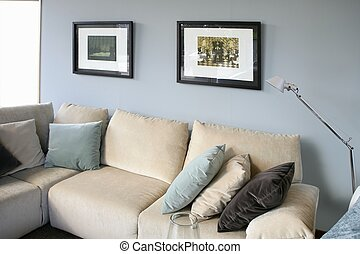 Living room with sofa and blue wall, interior design