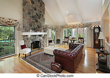 Living room with stone fireplace - Living room in home with ...