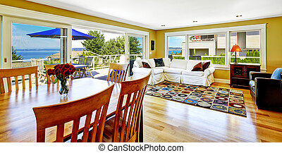Living room with walkout deck and bay view. Tacoma real estate,