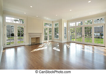 Living room in new construction home with wall of windows