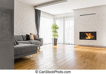 Living room with wood flooring, fireplace and sofa