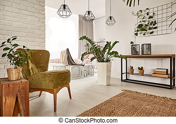 Living room with wooden furniture and stylish accessories