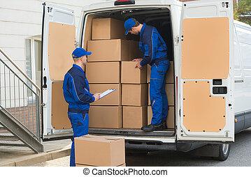livraison, boîtes, hommes, déchargement