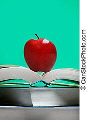 livre, pomme rouge