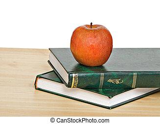 livres, pomme, bureau rouge