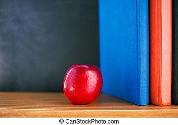 livres, pomme rouge