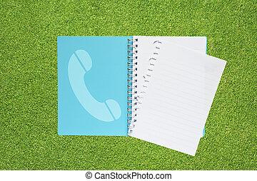 livro, com, telefone, ícone, ligado, capim, fundo