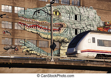Lizard graffiti on a building facade and train . Horizontal